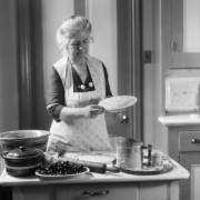 h-armstrong-roberts-1920s-1930s-senior-woman-grandmother-wearing-apron-crimping-crust-making-a-cherry-pie-in-kitchen