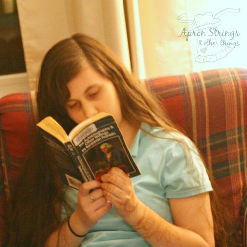 reading Benjamin Franklin for Hewitt Homeschooling Lightening Lit & Comp at ApronSTringsOtherThings.com