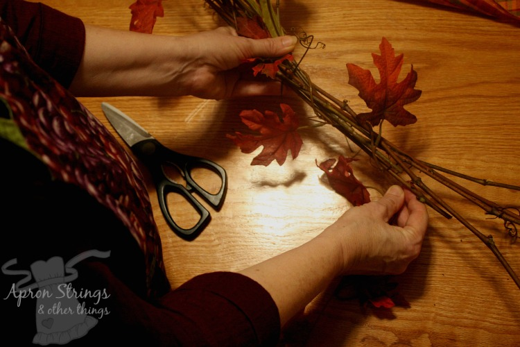 wrapping grapevines with autumn leaves at ApronStringsOtherThings.com